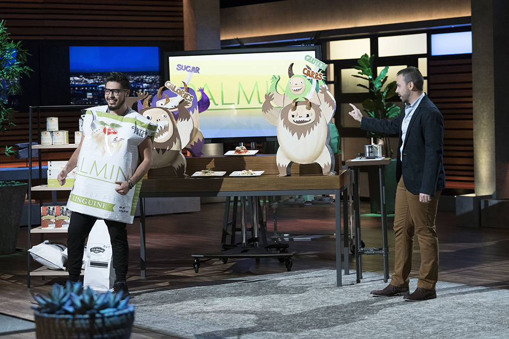 "Alfonso (right) pitching Palmini on the set of ""Shark Tank"""