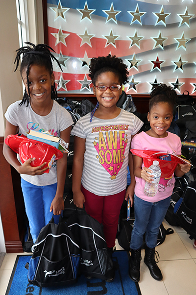 ►United Way of Broward County's Mission United teamed up with The Castle Group to distribute 525 backpacks filled with school supplies to children of local military families.