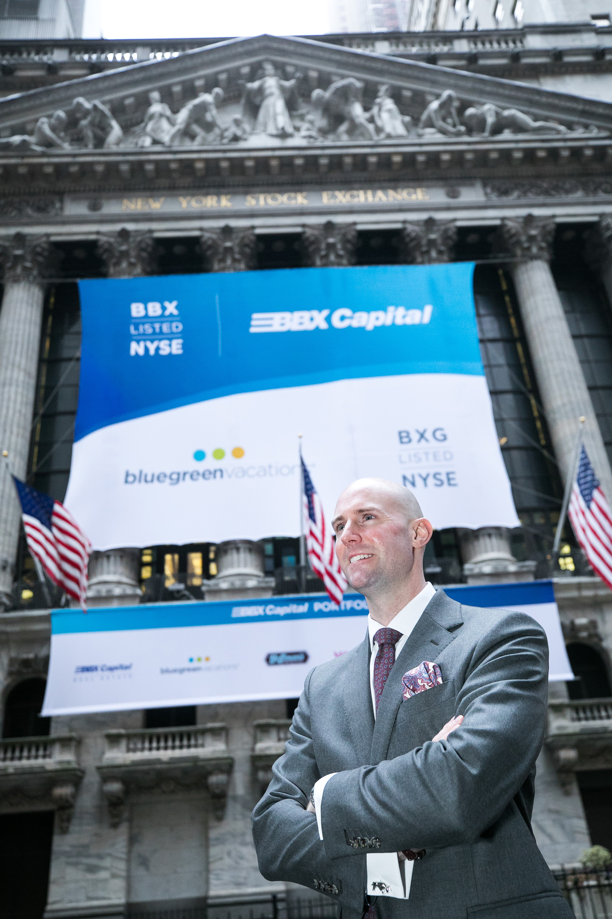 Pearson at the New York Stock Exchange in front of a banner for Bluegreen and parent BBX Capital