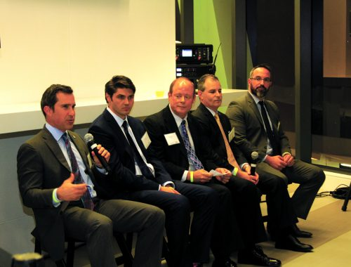 Austin Cook (left) discusses why emerging markets are a good bet for investment portfolios. Troy Sorel, Kevin Gale, Matthew J. Dernis and Jason E. Heller
