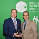 W. Allen Morris, chairman, president and CEO of The Allen Morris Co. receives a lifetime achievement award from Greater Miami Chamber of Commerce President and CEO Alfred Sanchez