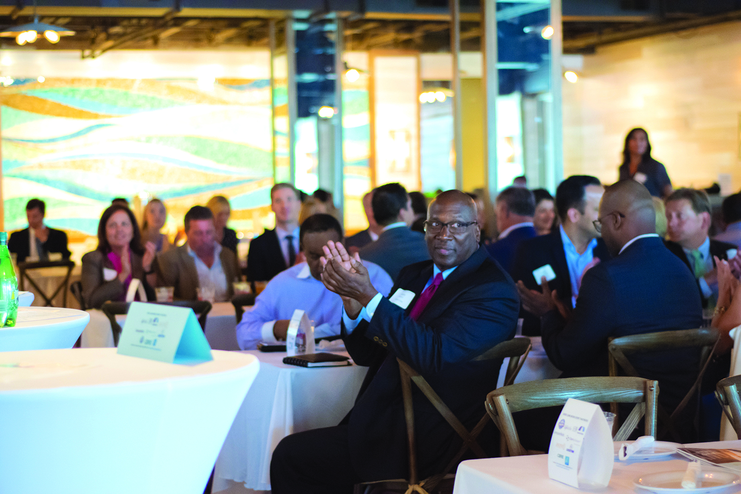 Members of the audience applaud during South Florida Executive Roundtable's presentation