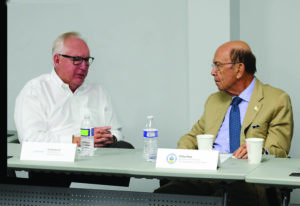 Ted Berglund, president and CEO of Dyplast Products, speaks with U.S. Commerce Secretary Wilbur Ross