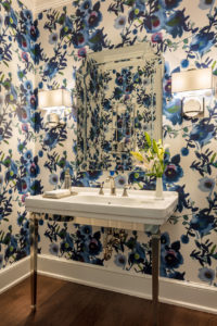 A bold floral powder room enlivens a Jupiter home.